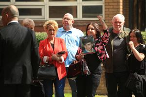 Donna Miller with a picture of her brother Paul Carlile, who died in the Hillsborough disaster (Danny Lawson/PA)