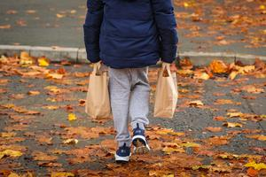 A child collects packed lunch bags (Peter Byrne/PA)