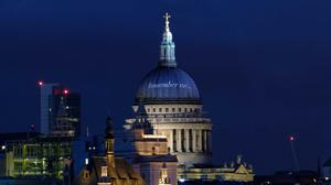 St Paul's famous dome is emblazoned, thanks to computer graphics, with the name of the new online memorial project. PA Wire