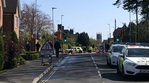 The scene in East Grinstead, where armed police and paramedics were seen on Tuesday after two men were injured in an assault (Hannah Turk/PA)
