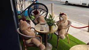 Cuddly toy bears sit in seats at Tagine in Balham to enforce social distancing at the restaurant (Zizou Hammoudi)