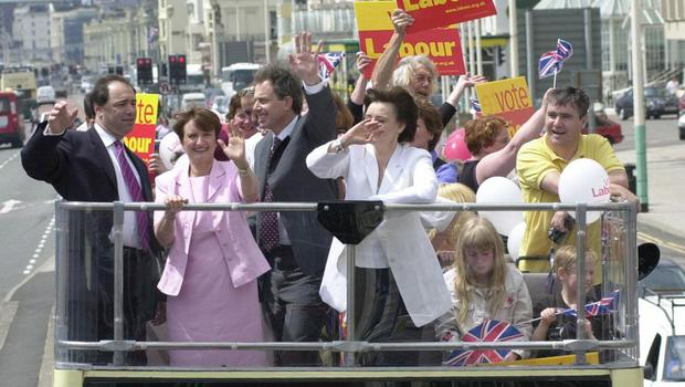 Prime Minister Tony Blair (centre left), alongside his wife Cherie Blair (centre right), takes an opentop bus tour through Brighton, East Sussex with Tessa Jowell in 2001 (Toby Melville/PA)