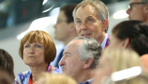 Dame Tessa Jowell (left) sits next to former prime minister Tony Blair during the evening swimming session at the Aquatics Centre in the Olympic Park, London, on the seventh day of the London 2012 Olympics. (Mike Egerton/PA)