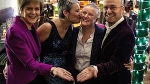 First Minister Nicola Sturgeon, left, and Patrick Harvie MSP, right, with Susan Douglas-Scott and Gerrie Douglas-Scott who will tie the knot in one of Scotland's first same-sex weddings (Elaine Livingstone/PA)