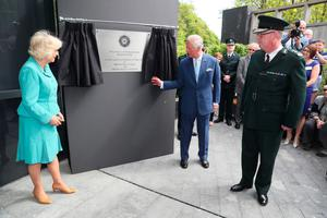 The royal couple unveil a plaque at PSNI headquarters yesterday as Chief Constable George Hamilton looks on