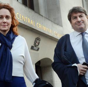 Former News International chief executive Rebekah Brooks and her husband Charlie Brooks leave the Old Bailey as the phone hacking trial continues.