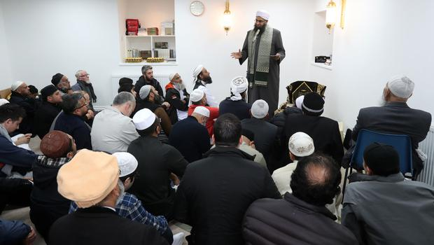 Iman Mufti Abdur Rahman Mangera speaks to members of the Muslim community in Stornoway on the Isle of Lewis as they attend the official opening of the first mosque in the Outer Hebrides (Andrew Milligan/PA)