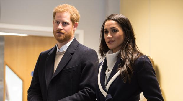 Harry and Meghan's decision has caused a raft of problems for royal aides (Oli Scarff/PA)