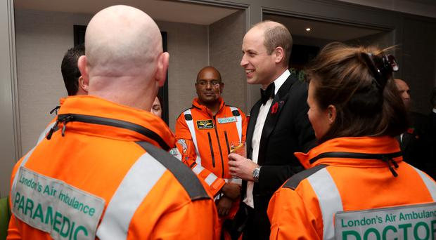 The Duke of Cambridge speaks with guests at London's Air Ambulance Charity gala (Chris Jackson/PA)
