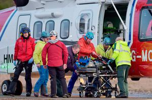 One of the casualties is ferried to hospital following the avalanche