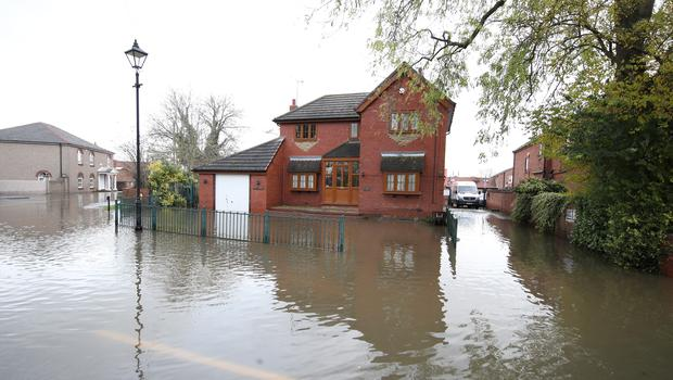 A house surrounded by water in Fishlake, near Doncaster (Danny Lawson/PA)