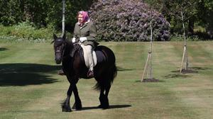 The Queen rides Balmoral Fern, a 14-year-old Fell Pony, in Windsor Home Park over the weekend (Steve Parsons/PA)