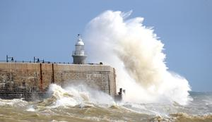 Waves crash over the harbour wall in Folkestone, Kent, on August 21 (Gareth Fuller/PA)