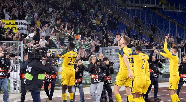 Celtic's players celebrate in front of their fans in Rome (Maurizio Brambatti/ANSA via AP)