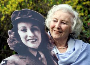 Dame Vera Lynn with an image of herself during the war (Sean Dempsey/PA)