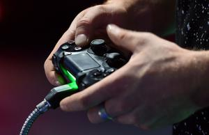 """File photo dated 22/9/2016 of a person playing a video game. Gaming companies risk """"setting kids up for addiction"""" by including gambling tasks in their video games, the director of mental health for the NHS said."""