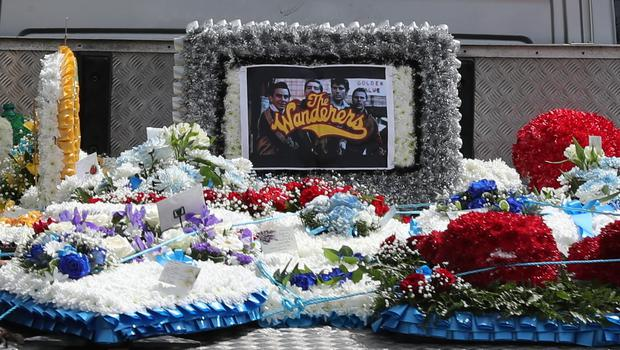 Flowers are displayed on the back of a vehicle that forms part of the funeral cortege of burglar Henry Vincent (Gareth Fuller/PA)