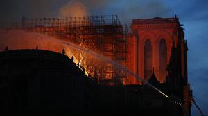 Firefighters tackle the blaze at Notre Dame (Francois Mori/AP)