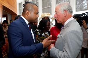 The Prince of Wales talks with Johnson Beharry (Phil Noble/PA)