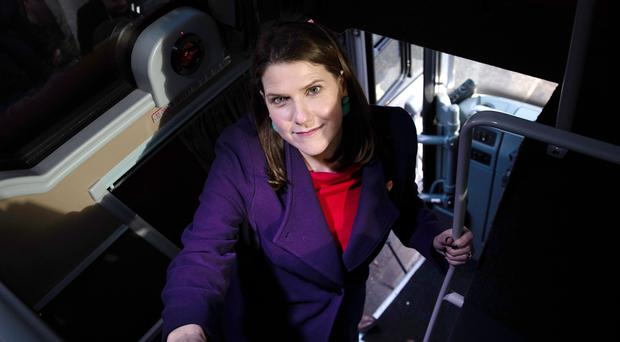 Liberal Democrat Leader Jo Swinson climbs aboard her campaign bus (Aaron Chown/PA)