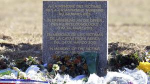 Flowers in front of a monument in the area where a Germanwings aircraft crashed in the French Alps, killing all 150 people on board (AP)