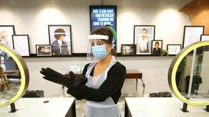 Salons say their staff will be required to wear visors and aprons (Jonathan Brady/PA)