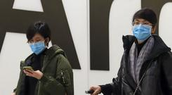 Passengers in the arrivals concourse at Heathrow (Steve PArsons/PA)