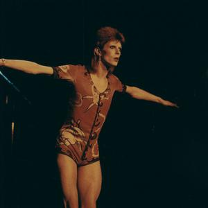 David Bowie in the Ziggy Stardust outfit which was worn by Kate Moss as she accepted his British male award (Bowie PR/PA)