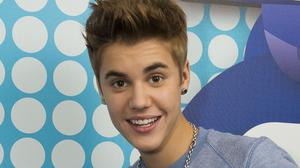 Canadian pop star Justin Bieber is reported to have taunted actor Orlando Bloom after an altercation in Ibiza