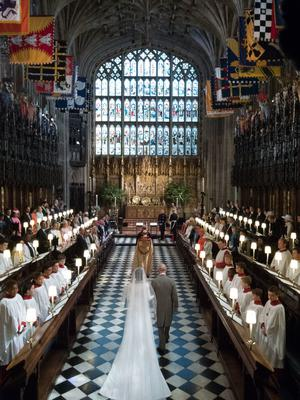 Meghan Markle was met by the Prince of Wales half way up the aisle amid the splendour of St George's Chapel. (Dominic Lipinski/PA)