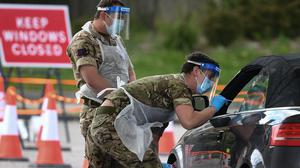 Members of the armed forces take swabs at a drive-in coronavirus testing facility at the Chessington World of Adventures Resort in south-west London (Kirsty O'Connor/PA)