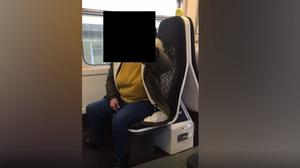 Screen grab from handout footage issued by Sense of a passenger on a Merseyrail train who challenged Karolina Pakenaite, 24, who is deafblind, and her sister, Saule, 16, who has Usher's Syndrome (Sense/PA)