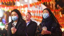 People wearing masks in China Town, London (Victoria Jones/PA)