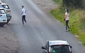 A second male (left) is then seen running from where the Renault had crashed. (West Midlands Police/PA)
