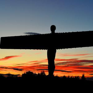 The sun sets over the Angel of the North in Gateshead as the warm weather continues