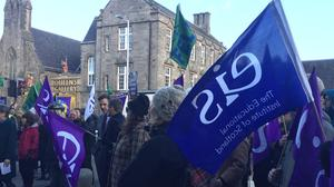 College lecturers striking earlier this year over pay outside the Scottish Parliament (Tom Eden/PA)