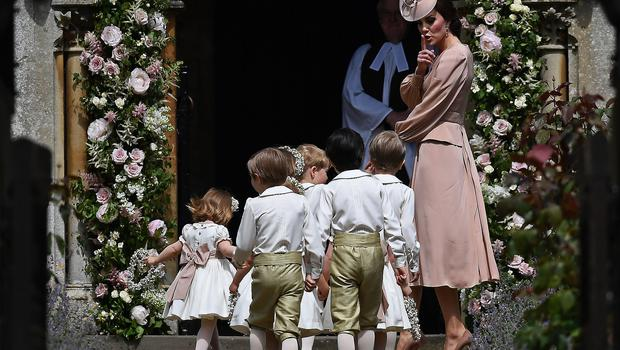 Kate tells the young helpers to be quiet at Pippa's wedding (Justin Tallis/PA)