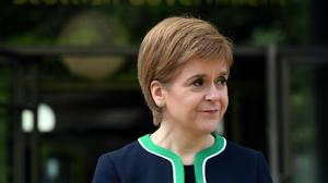 Nicola Sturgeon has said Scotland will continue to issue the 'stay at home' advice to tackle the coronavirus outbreak (Andy Buchanan/PA)