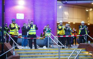Construction workers clapping outside the Nightingale Hospital at the Harrogate Convention Centre (Danny Lawson/PA)