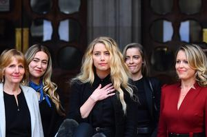 Amber Heard alongside her sister Whitney Henriquez (second right) and lawyer Jen Robinson (right), outside the High Court (Victoria Jones/PA)