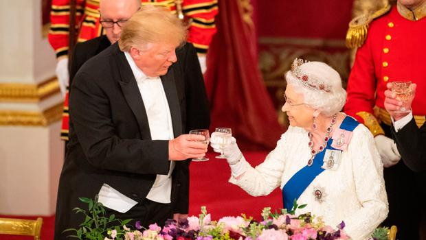 US President Donald Trump and the Queen share a toast during the state banquet last night