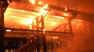 The structure was engulfed in flames (Tyne and Wear Fire and Rescue Service/PA)