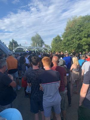 A crowd of people at Thorpe Park in Surrey after reports a police incident at the park (@abbiesear29)