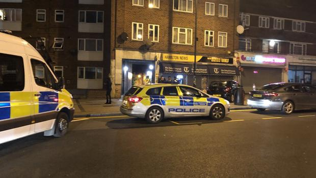 Police at the scene outside Queensbury Tube station (@keval_91/PA)