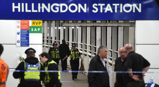 Police outside Hillingdon Underground station in London, where a murder investigation has been launched after a man was stabbed to death (David Mirzoeff/PA)