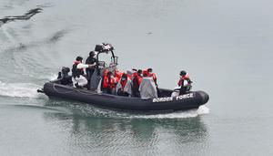 A Border Force vessel carries a group of people thought to be migrants (Gareth Fuller/PA)