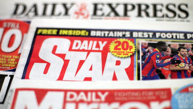 Trinity Mirror's £126.7 million deal to buy titles including the Daily Express and the Daily Star has been referred to media and competition watchdogs after the Government intervened on the grounds of public interest (Yui Mok/PA)