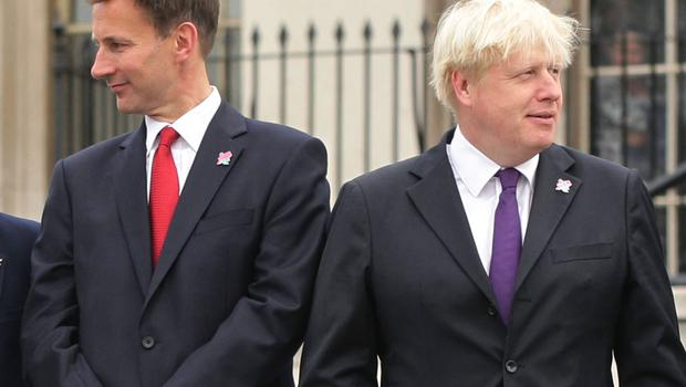 Boris Johnson has made a 'do or die' commitment to leave the EU, but Jeremy Hunt has called October 31 a'fake deadline' (Yui Mo/PA)