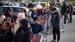 Hundreds of people queue to enter a Costco Wholesalers in Coventry (Jacob King/PA)