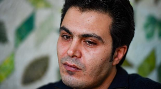 Saman, an Iranian refugee, is rebuilding his life in the UK after fleeing torture and risking his life in a refrigerated lorry to reach safety (Jacob King/PA)